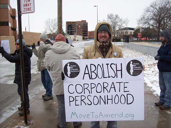 "Top Pun with ""Abolish Corporate Personhood"" sign in front of federal courhouse in Toledo, Ohio, at Move To Amend protest sponsored by Occupy Toledo"
